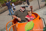 Grandfather and grandson on carnival ride