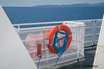 Life preserver on a ferry boat attached to the side of the boat on the Black Ball Ferry called Coho Seattle