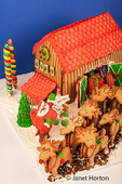 Homemade gingerbread setup of Santa's barn, sled, raindeer and Santa