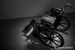Wheelchair facing away, reinforcing the feeling of isolation and depression that can be associated with personal injury