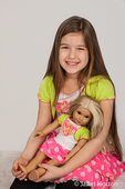 Nine year old girl with her American Girl doll, Julie, in matching outfits