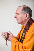 Portrait of a Buddhist priest with his prayer beads in prayer