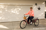 Woman riding a three wheel bicycle in Columbus, Ohio.  The two rear wheels ensure that you are safe and secure and won't lose your balance.