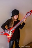 Ten year old girl acting like she is playing a pretend guitar in Issaquah, Washington, USA