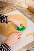 Ten year old girl cutting out Christmas sugar cookies