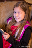 Ten year old girl playing with her tablet PC she received for Christmas
