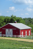 Well-maintained red and white barn with white, wooden fence, near Galena, Ilinois, USA