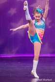 "Ten year old girl doing a standing splits in a Jazz dance performance to the tune of ""These Boots"""