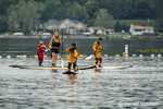 Woman teaching pre-teens and teens how to paddleboard