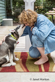 """Dashiell, a three month old Alaskan Malamute puppy practicing a """"watch me"""" command, giving his owner a kiss"""