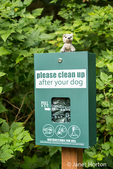 Dispenser of dog waste bags to encourage dog owners to clean up after their dogs in a park