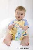 Seven month old baby boy playing with a toy