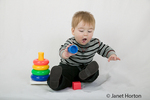10.5 month old boy playing with toys
