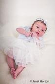 Twelve day old baby girl wearing her ballerina dress