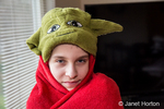 14 year old boy showing off his Yoda outfit