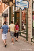 Two young men and a woman shopping on Main Street, Galena, Illinois, USA