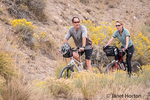 Couple trail cycling near the Mammoth Hot Springs Hotel