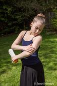 Eleven year old girl applying sunscreen