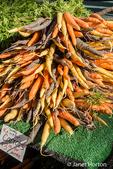 Pile of organic rainbow carrots at a Farmers' Market