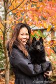 "Woman holding her Schipperke puppy ""Cash"" on an Autumn day in Maple Valley, Washington, USA"