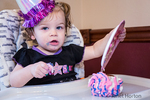 Oops, one birthday cupcake bites the dust as the one year old birthday girl dumps the plate upside down