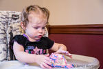 One year old birthday girl finds that birthday cake is so much fun to play in