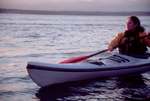 Woman sea kayaking Puget Sound, Seattle area.