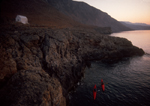 Crete, Greece, Sea Kayakers explore the southwest coast, Mediterranean Sea, Europe, Greek Orthodox chapel, Feathercraft breakdown aluminum and fabric sea kayaks, sunrise,