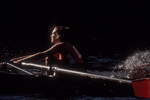 Rowing, Head of the Charles Regatta, Cambridge; Massachusetts; Charles River; Boston, New England, USA, collegiate woman athlete in the bow of an eight oared racing shell,