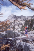 Woman Hiker, The Enchantments, Alpine Lakes Wilderness Area, Central Cascade Mountains, Washington State, Pacific Northwest, U.S.A., Autumn Larch trees,