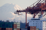 Seattle; Container Ship; Mount Rainier; Container Cranes; Elliott Bay; Puget Sound; Washington State.