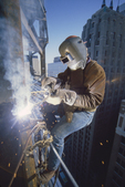 Welder, Seattle, constructing a high rise office building, Washington State, Pacific Northwest, USA,