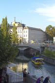 Slovenia, Ljubljana, Ljubljanica River, Old Town, August afternoon strollers, pedestrian friendly, car-free environment, Baroque architecture, Europe, European Union,