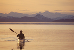 Alaska, Sea kayaker explores Alaska's Prince William Sound's Knight Island Passage, sunset,