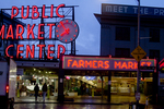 Seattle, Pike Place Farmer's Market, Historical District, Washington State, Pacific Northwest, USA, Central Arcades, Saturday morning set up at Pike Place Fish, one of many fish markets in the district, neon signage, reflected across First Avenue, founded in 1907.