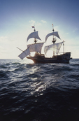 The Golden Hind, Sir Francis Drake's historic sailing ship replica under full sail, off the US west coast at sunrise, commemorating Drake's around the world (1577-1580) Voyage of Discovery, property released,
