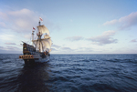 The Golden Hind, Sir Francis Drake's historic 16th century sailing ship replica under full sail, off the US west coast at sunrise, commemorating Drake's around the world Voyage of Discovery, (1577-1580), property released, 