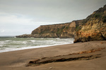 CALIFORNIA - Colorful sandstone bluffs at Kelham Beach on the shores of Drakes Bay in Point Reyes National Seashore.