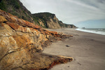 CALIFORNIA - Colorful weathered and eroded sandstone bluffs at Kelham Beach on the shores of Drakes Bay in Point Reyes National Seashore.