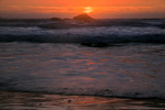 CALIFORNIA - The sun setting over the Pacific Ocean from Hidden Beach in the coastal portion of Redwood National Park.