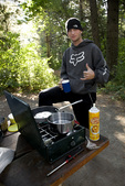 WASHINGTON - Erik Spring cooking pancakes from an aerosol can on a camping trip.