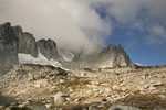 WASHINGTON - Cloud covered Dragontail Peak from Isolation Lake in the Upper Enchantment Lakes Basin of the Alpine Lakes Wilderness in the Wenatchee National Forest.