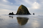 Oregon- Haystack Rock at sun rise on the Pacific Coast in Cannon Beach.