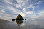 OREGON - Sunrise at Cannon Beach with Haystack Rock at the oceans edge.