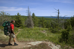 MICHIGAN - Hiker on the Greestone Ridge Trail east of Ishpeming Point in Isle Royale National Park.