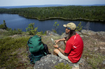 MICHIGAN - Hiker on the Minong Ridge Trail above Otter Lake in Isle Royale National Park.