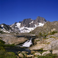 CALIFORNIA - Bridge across the end of Garnet Lake at the base of Mount Ritter and Banner Peak in the Ansel Adams Wilderness area of the Inyo National Forest.