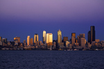 WASHINGTON - The highrises of downtown Seattle and the waterfront, including the Great Wheel, on Elliot Bay at dusk from West Seattle.
