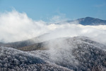 Fog lifts off the mountains leaving them coated with rime ice, from Max Patch, Pisgah National Forest, NC, winter