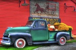 A classic truck adorned with fall products sits near the Vermont Country Store.
